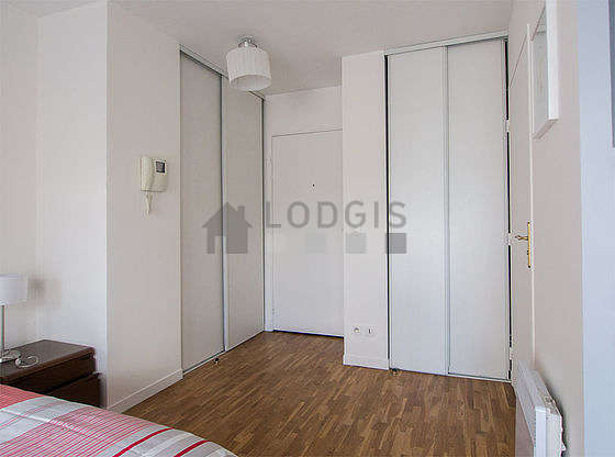 Very bright living room furnished with cupboard