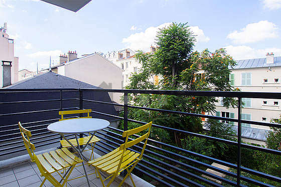 Very quiet and very bright balcony with its tile floor