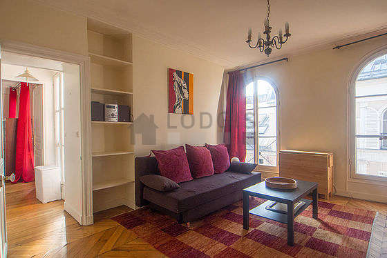 Quiet living room furnished with 1 sofabed(s) of 120cm, tv, hi-fi stereo, cupboard