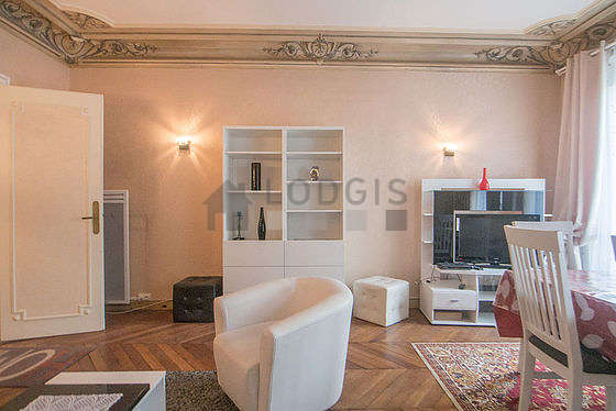 Living room furnished with tv, fan, 4 chair(s)