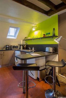 Magnifique cuisine avec des tomettes au sol