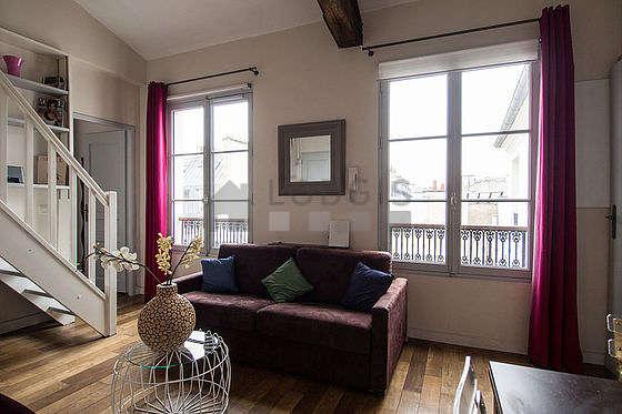 Beau séjour très calme et très lumineux d'un appartement à Paris