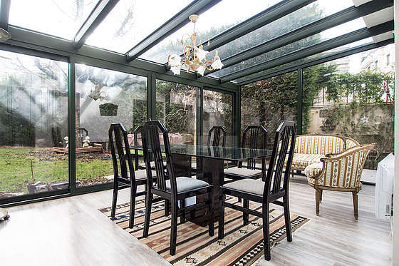 Quiet and very bright veranda equipped with sofa, 1 armchair(s), storage space
