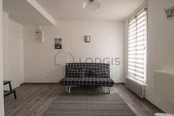 Living room furnished with 1 sofabed(s) of 140cm, dining table, wardrobe, cupboard