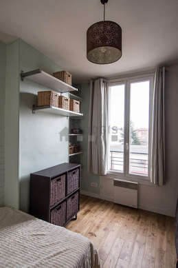 Bedroom with double-glazed windows facing the road