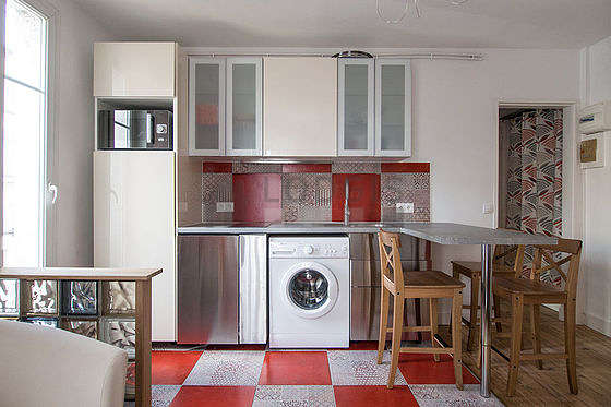 Kitchen where you can have dinner for 2 person(s) equipped with washing machine, refrigerator, cookware