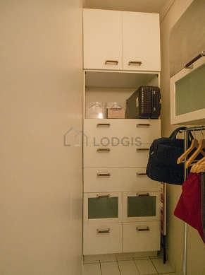 Quiet walk-in closet with tile floor