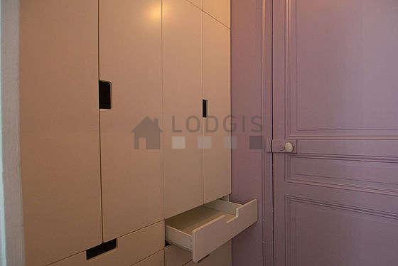 Quiet walk-in closet with wooden floor