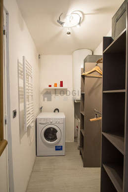 Beautiful laundry room with linoleum floor and equipped with washing machine, dryer