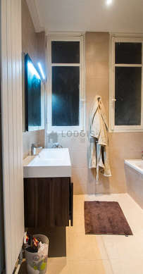 Beautiful bathroom with windows and with tile floor