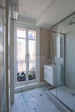 Beautiful and bright bathroom with windows and with tile floor