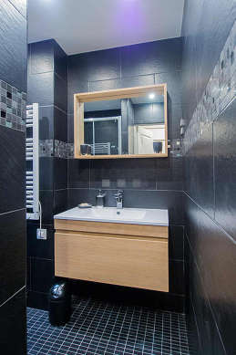 Beautiful bathroom with double-glazed windows and with tile floor
