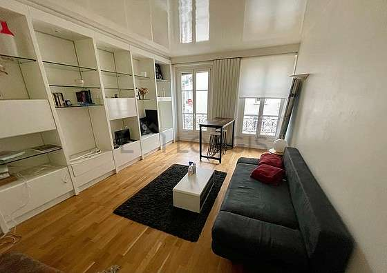 Quiet living room furnished with tv, 6 chair(s)
