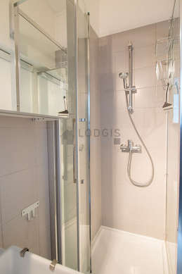 Bathroom equipped with washing machine, cupboard, electric toilet