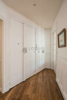 Beautiful entrance with wooden floor and equipped with washing machine