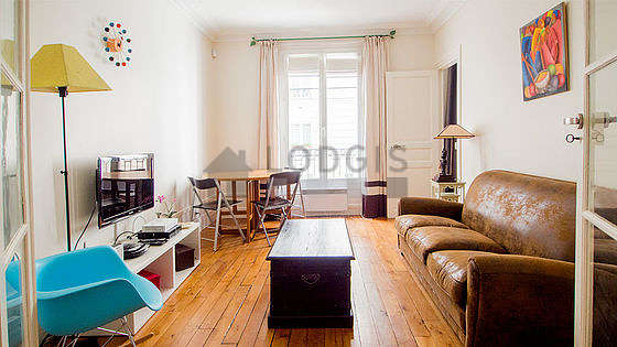 Very quiet living room furnished with tv, hi-fi stereo, 3 chair(s)