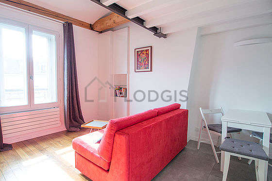 Living room furnished with 1 sofabed(s) of 140cm, dining table, coffee table, cupboard