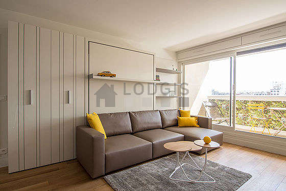 Very quiet living room furnished with 1 murphy bed(s) of 150cm, tv, wardrobe, cupboard