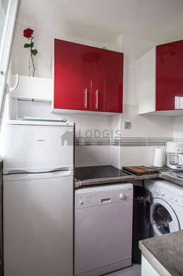 Kitchen where you can have dinner for 2 person(s) equipped with washing machine, dryer, refrigerator, crockery