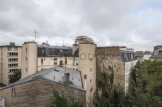 Séjour calme et très lumineux d'un appartement à Paris