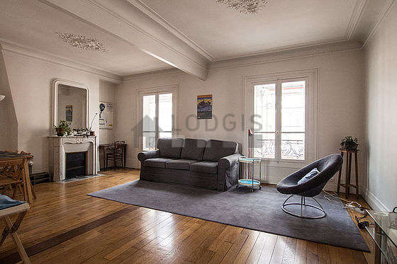 Quiet living room furnished with tv, 2 armchair(s), 6 chair(s)