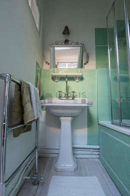 Beautiful and bright bathroom with linoleum floor