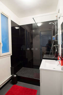 Pleasant bathroom with double-glazed windows and with tile floor