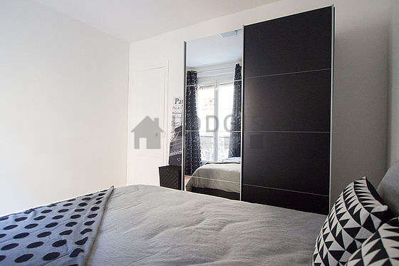 Very bright bedroom equipped with closet