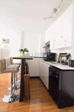 Kitchen where you can have dinner for 3 person(s) equipped with dishwasher, hob, refrigerator, cookware