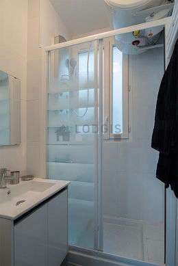 Bathroom with double-glazed windows and with tile floor