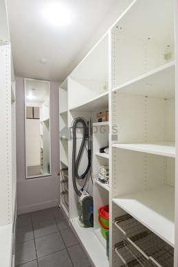 Very quiet walk-in closet with tile floor