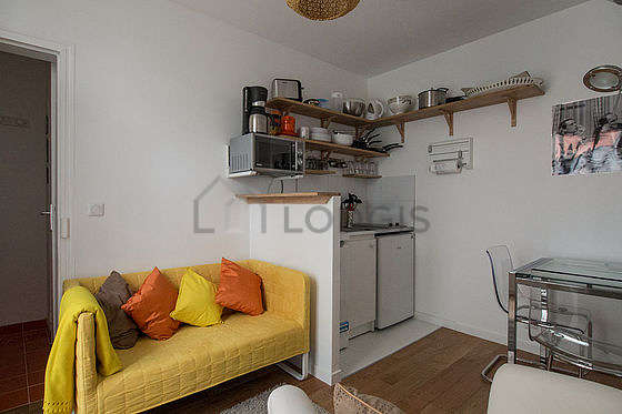 Very quiet living room furnished with tv, 1 armchair(s), 2 chair(s)
