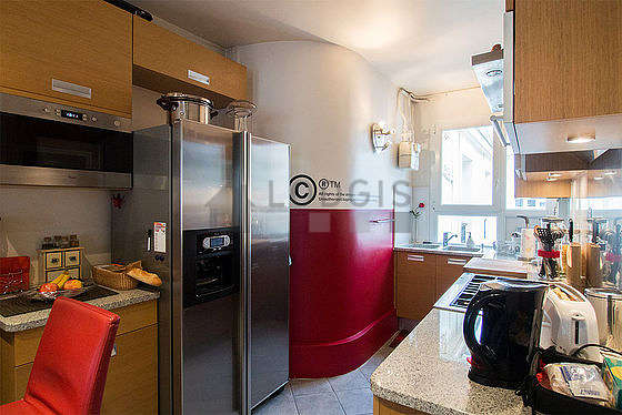 Kitchen where you can have dinner for 2 person(s) equipped with dishwasher, refrigerator, extractor hood, crockery