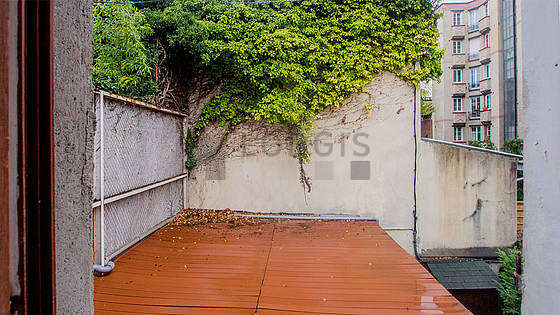 Very quiet and very bright balcony with concrete floor