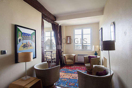 Quiet living room furnished with tv, hi-fi stereo, 4 armchair(s), 2 chair(s)