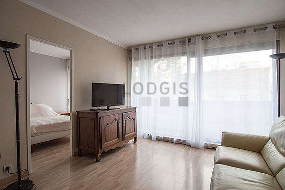 Quiet living room furnished with 1 sofabed(s) of 130cm, tv, closet, 6 chair(s)
