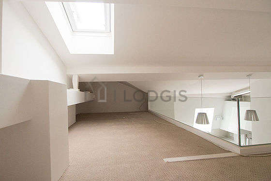Mezzanine with a high ceiling with a carpeting floor