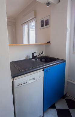 Kitchen equipped with washing machine, extractor hood, crockery