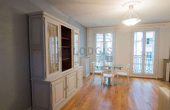 Quiet living room furnished with 1 sofabed(s) of 160cm, dining table, wardrobe, cupboard