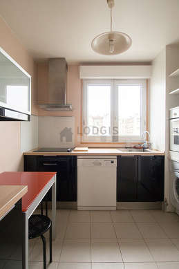Kitchen where you can have dinner for 2 person(s) equipped with washing machine, refrigerator, hood, cookware