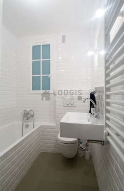 Pleasant bathroom with double-glazed windows and with concrete floor