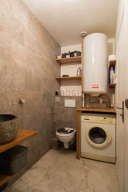 Bathroom equipped with washing machine, separate shower, hair-dryer