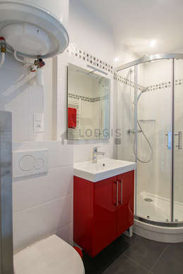 Bathroom equipped with washing machine, cupboard