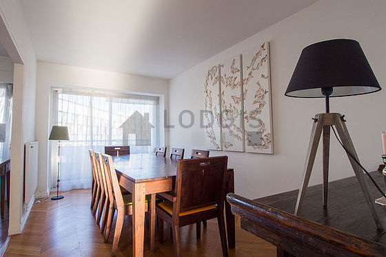 Beautiful dining room with wooden floor for 8 person(s)