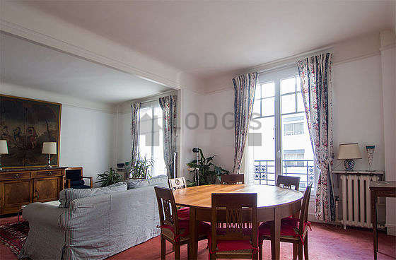 Dining room with wooden floor for 6 person(s)