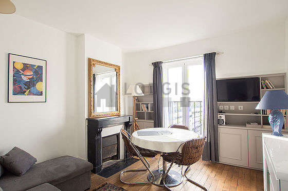 Quiet living room furnished with 1 sofabed(s) of 80cm, tv, storage space, 3 chair(s)