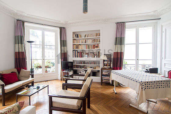 Living room with windows facing the road