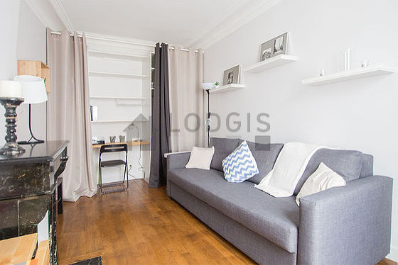Quiet living room furnished with 1 bed(s) of 140cm, tv, wardrobe, cupboard