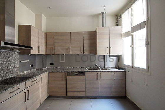 Kitchen where you can have dinner for 4 person(s) equipped with washing machine, refrigerator, hood