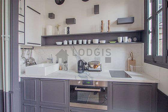 Magnifique cuisine de 0m²ouverte sur le séjour avec du carrelage au sol